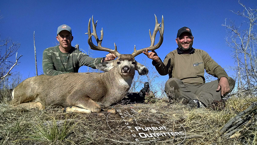 EPO guides, John & Jimmy holding Steve's big buck.