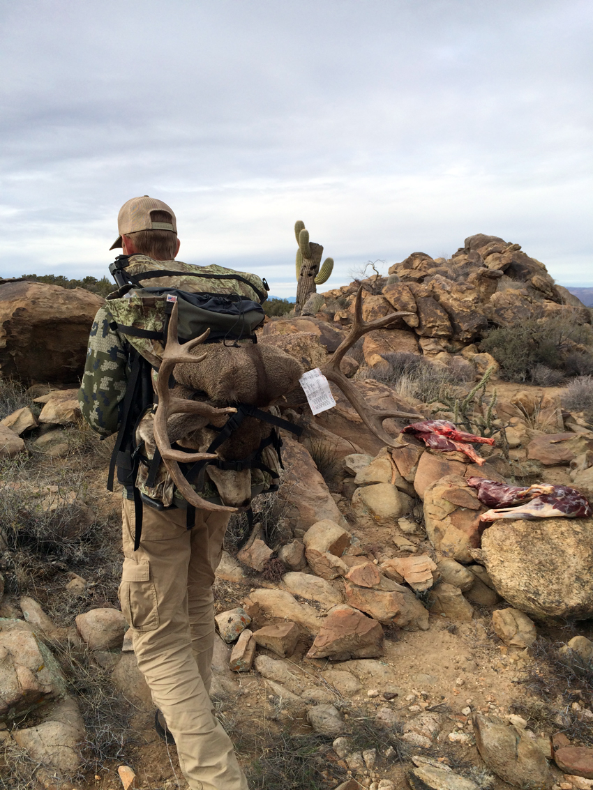 Lee packing out Troy's Archery Mule Deer in the Outdoorsmans Pack.