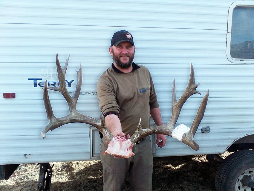Jimmy Hoffman holding Steve's brusier 12AE buck!